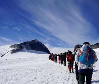 Hiking across a glacier with BiT Bible School in Norway